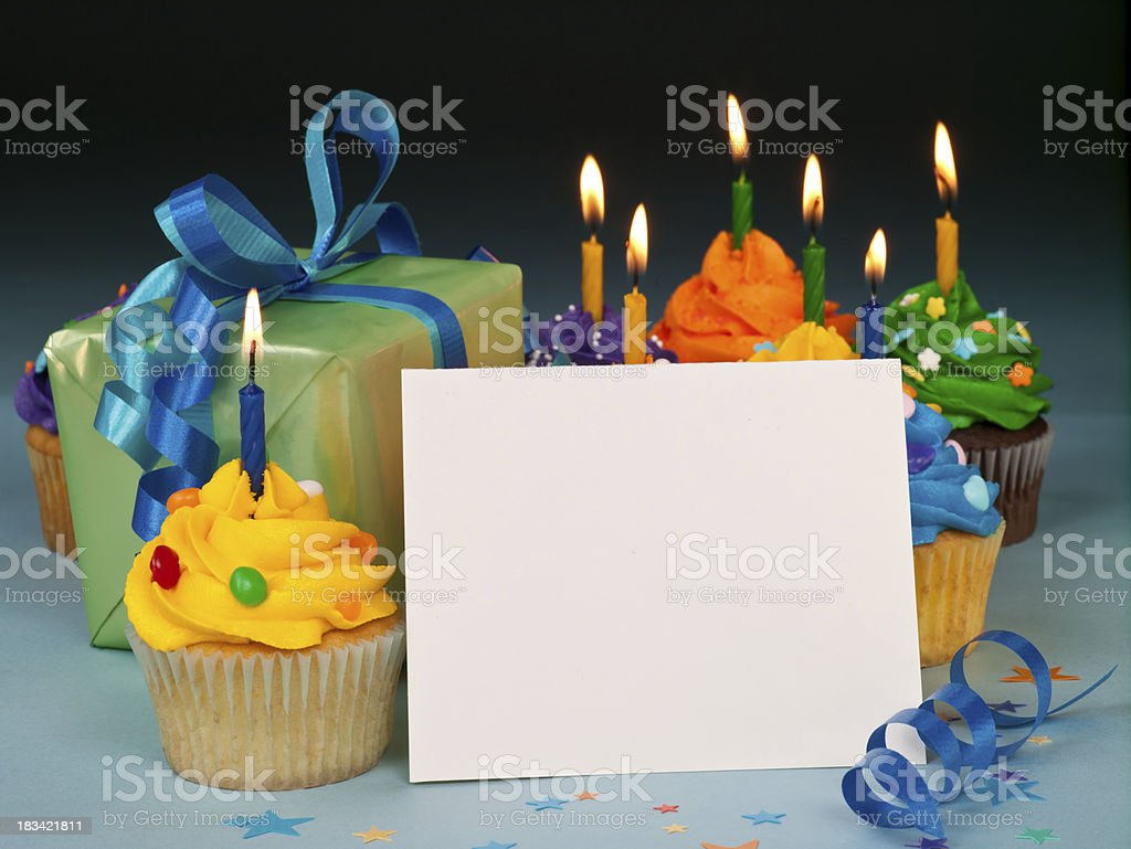Celebration cupcakes with blank card stock photo