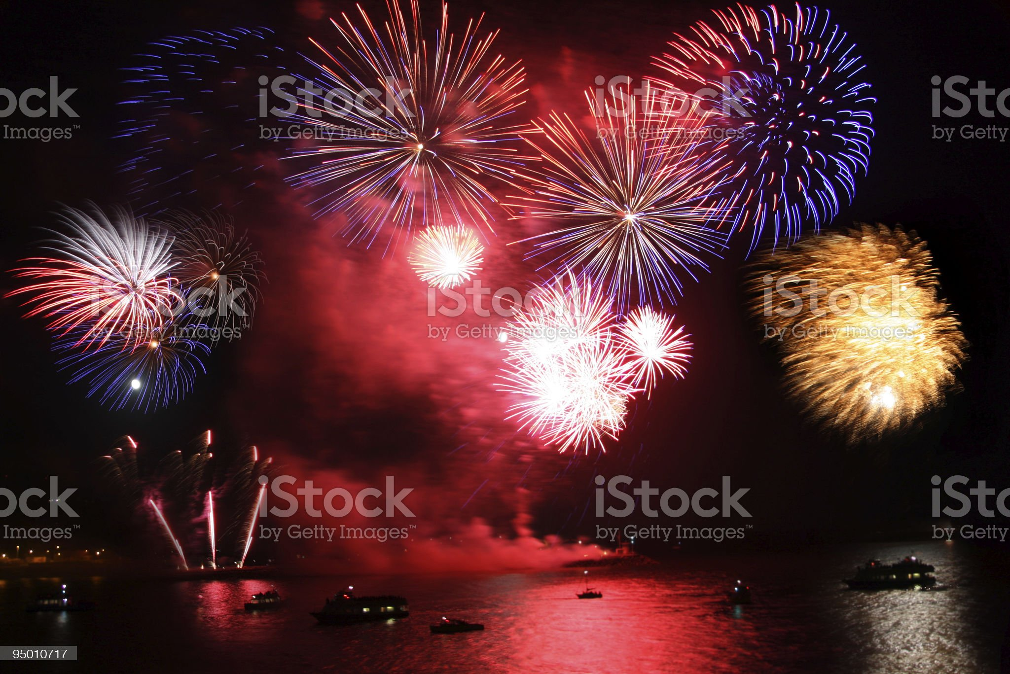 celebration of the new year, firework over  sea royalty-free stock photo