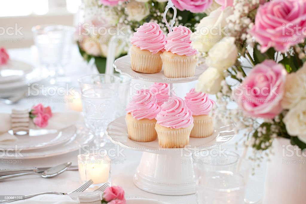 Celebration party cupcakes and candles dining table stock photo