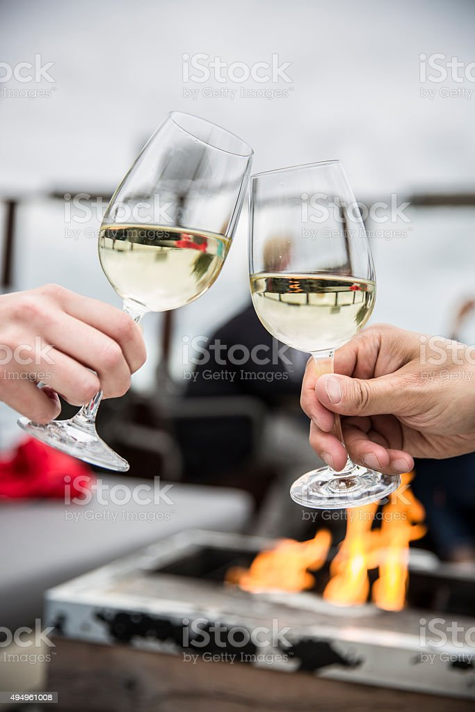 Celebration. People holding glasses of white wine making a toast stock photo