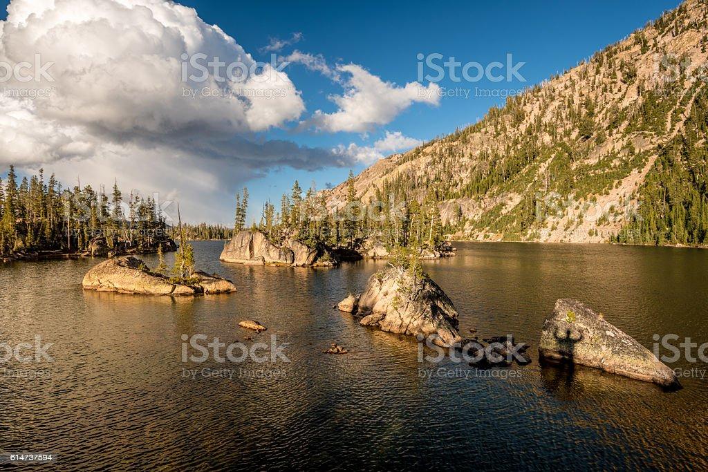 Celebration shadow on rock in Lake stock photo