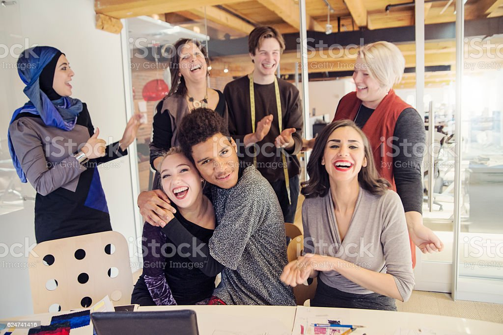 Celebration time for small creative start-up enterprise lead by woman. stock photo