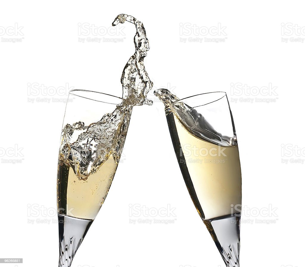Celebration toast with pair of champagne flutes stock photo