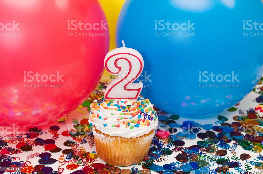 Celebration with Balloons, Confetti, and Cupcake stock photo