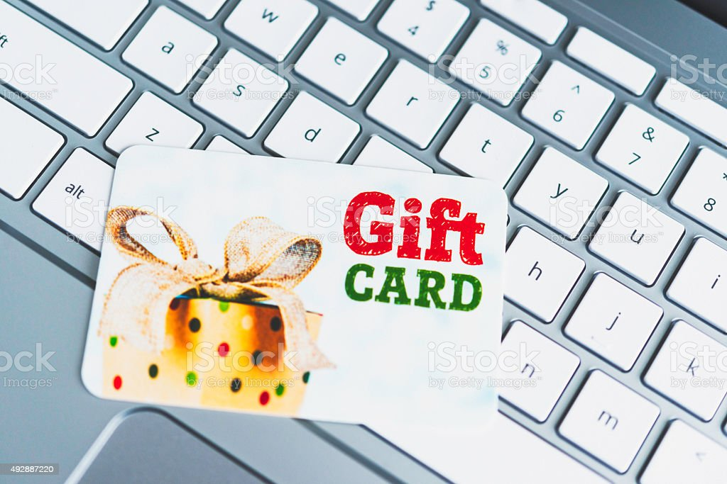Celebrations gift card on laptop keyboard. Shopping for celebrations online. stock photo