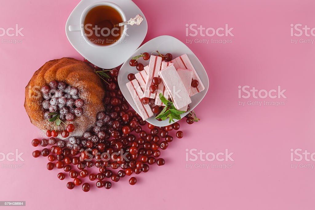 Celebratory chocolate cake with canned cherry, cup of tea stock photo