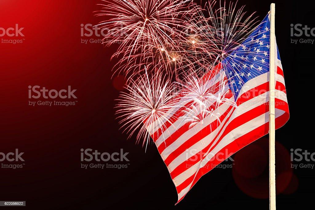 Celebratory fireworks on the background of the US flag stock photo