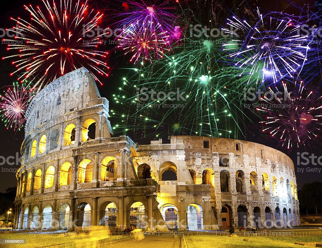 Celebratory fireworks over Collosseo. Italy. Rome royalty-free stock photo