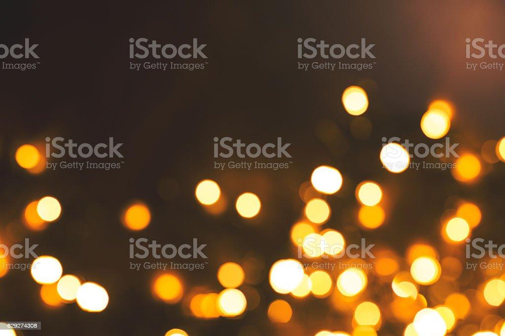 Celebratory lights in a dark background stock photo