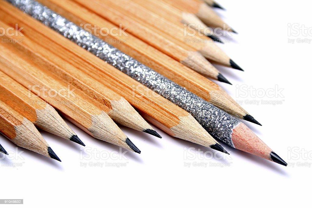Celebratory pencil among usual pencils on a diagonal royalty-free stock photo