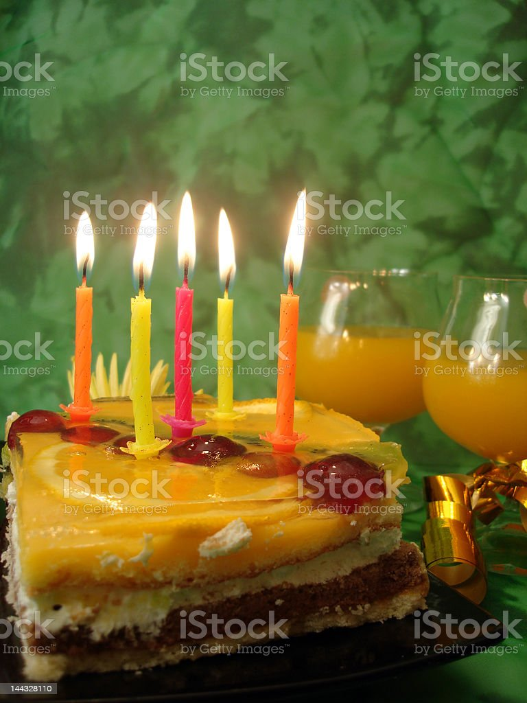 celebratory table (cake and candles, two glasses) on green royalty-free stock photo