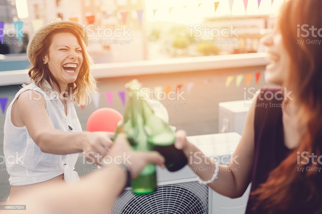 Celebratory toast on the rooftop for a birthday party stock photo