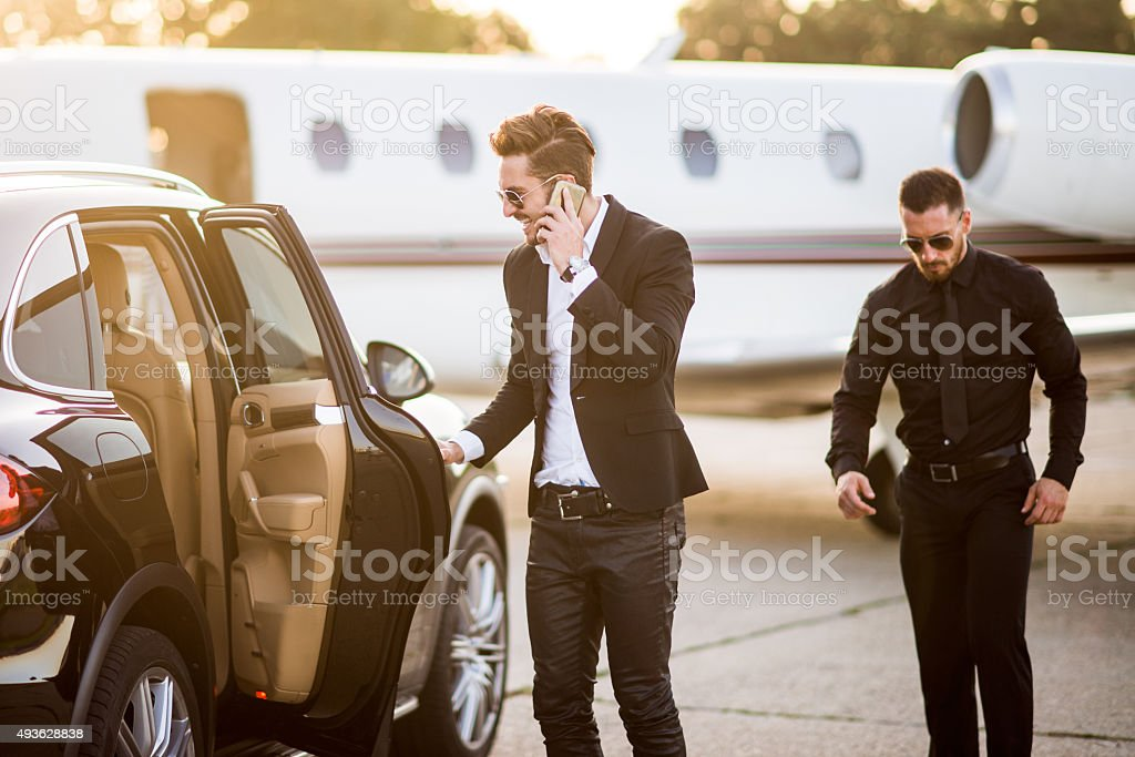Celebrities at the airport stock photo