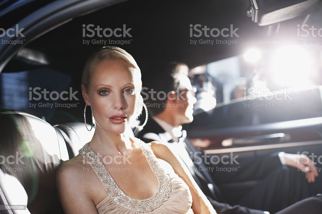 Celebrities posing for paparazzi in backseat of car royalty-free stock photo