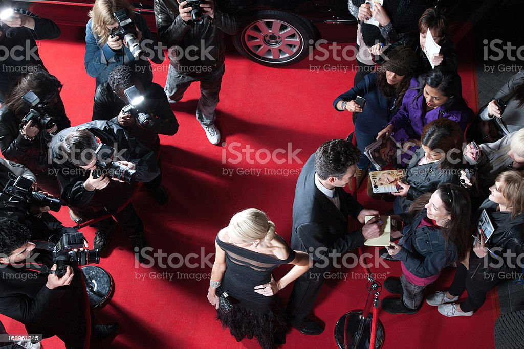 Celebrities working on red carpet stock photo