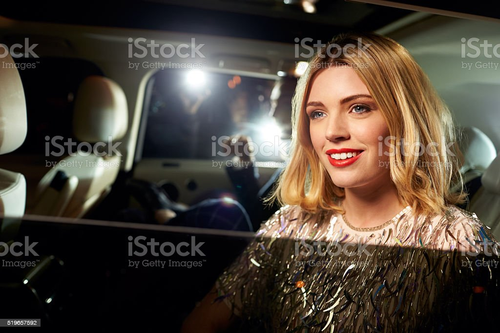 Celebrity couple arriving in limo, photographed by paparazzi stock photo