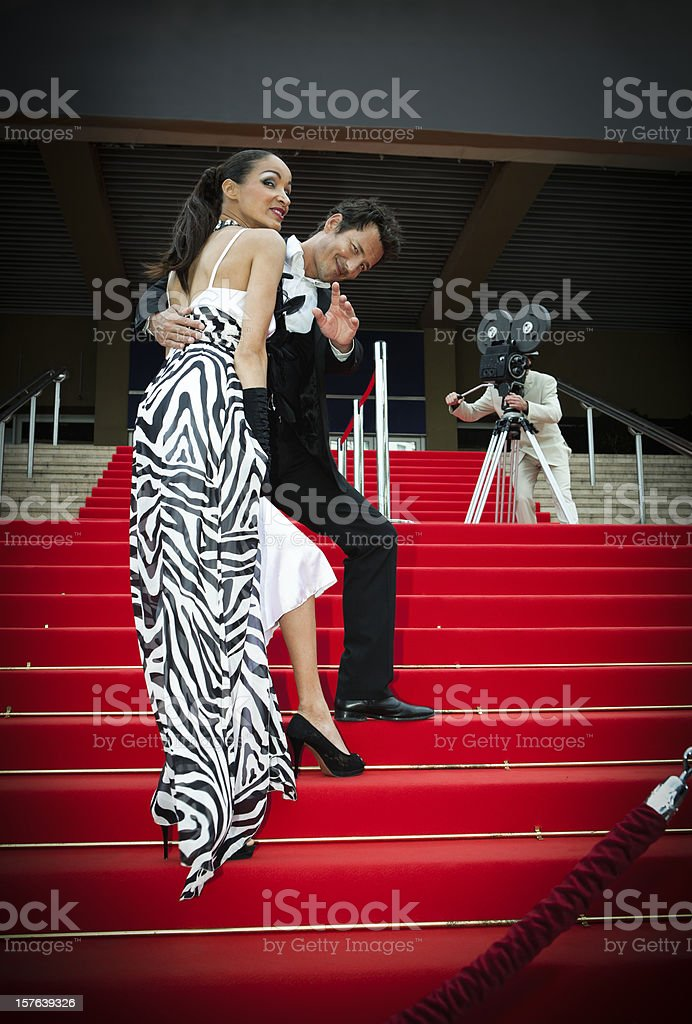 Celebrity couple on red carpet stock photo