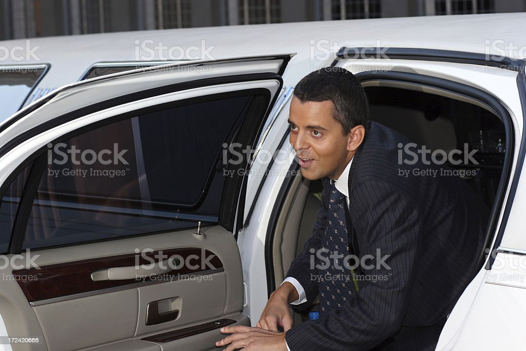 Celebrity getting out of limousine royalty-free stock photo