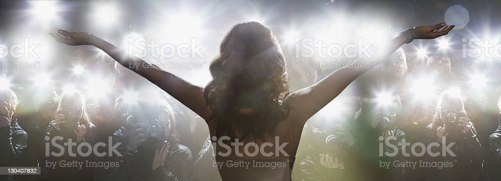 Celebrity posing for paparazzi royalty-free stock photo