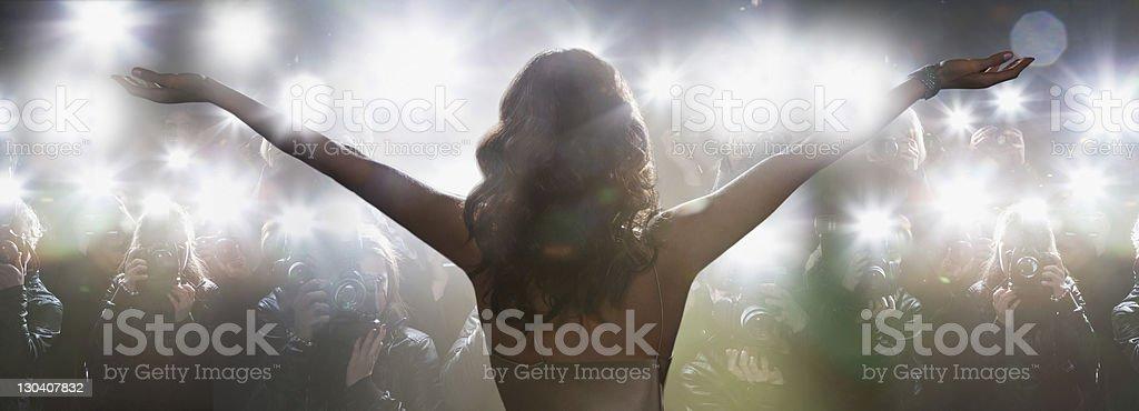 Celebrity posing for paparazzi stock photo