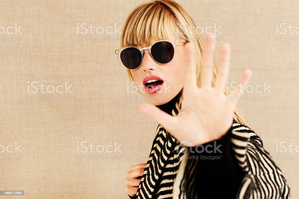 Celebrity rejecting attention stock photo