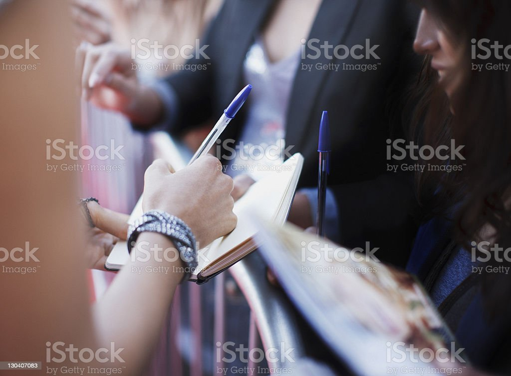 Celebrity signing autographs for fan stock photo