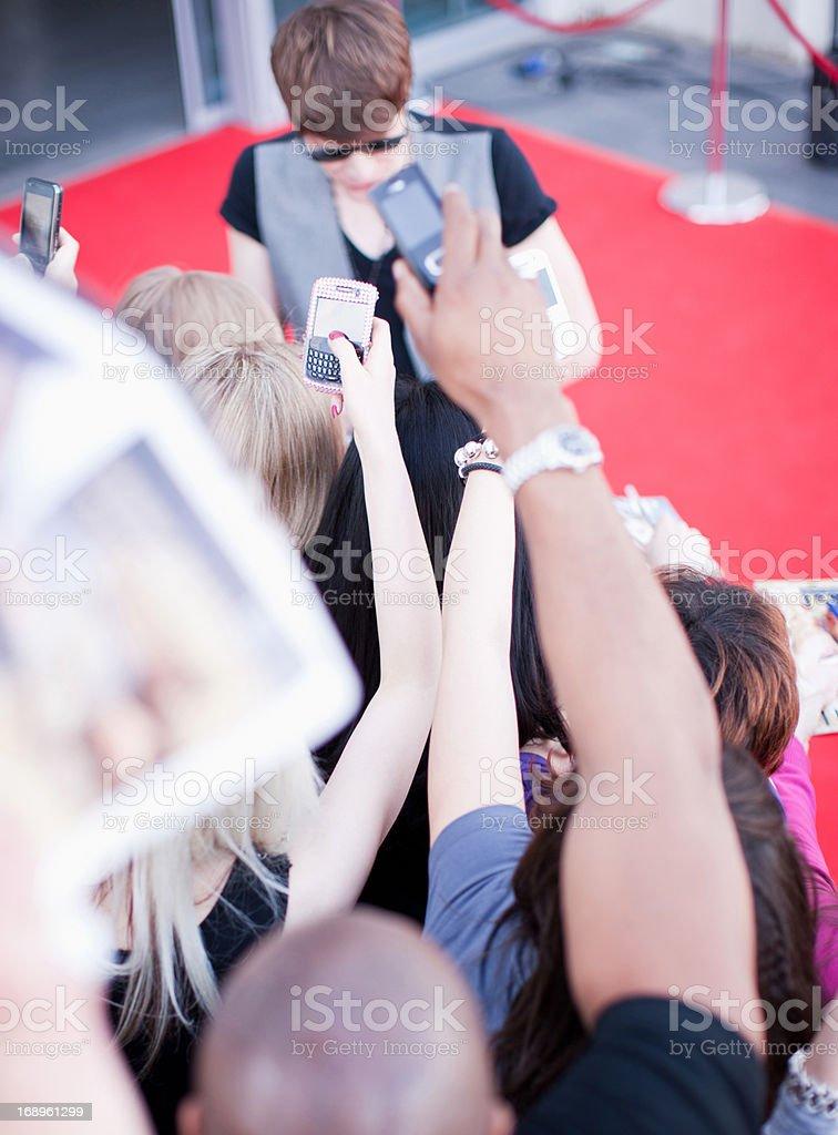 Celebrity signing autographs royalty-free stock photo