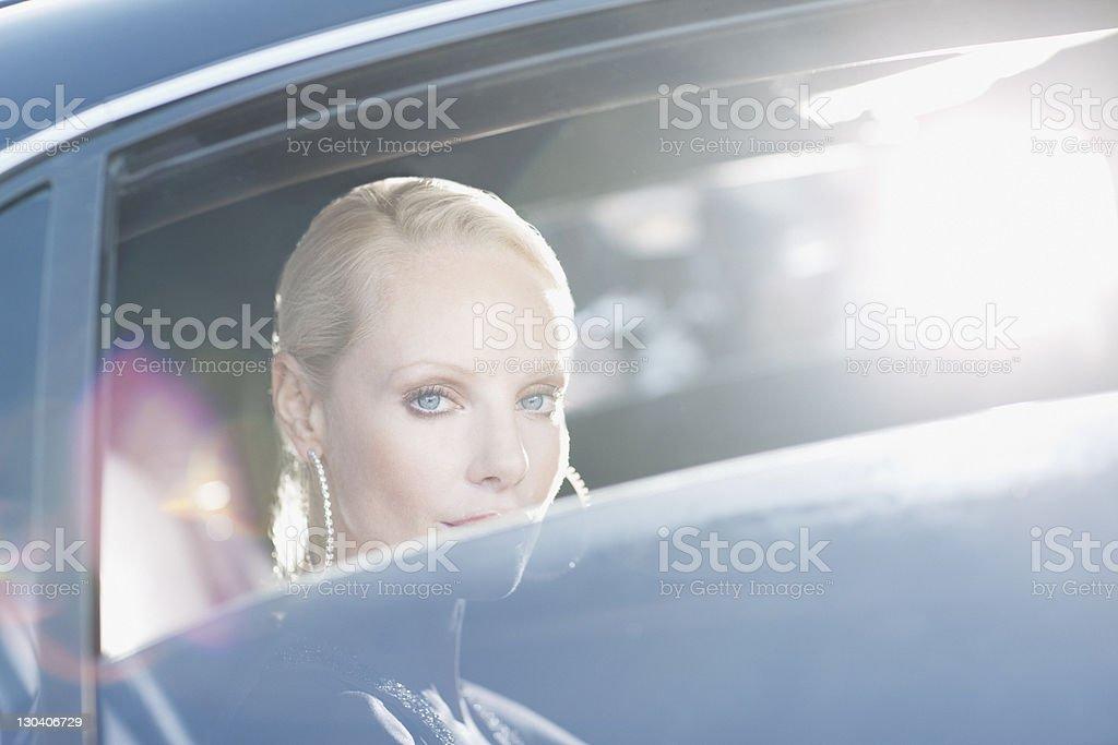 Celebrity sitting in backseat of car stock photo
