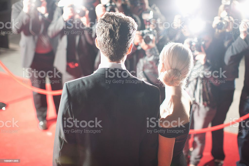 Celebrity standing on red carpet stock photo