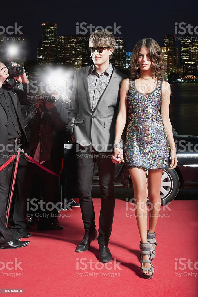 Celebrity walking on red carpet stock photo