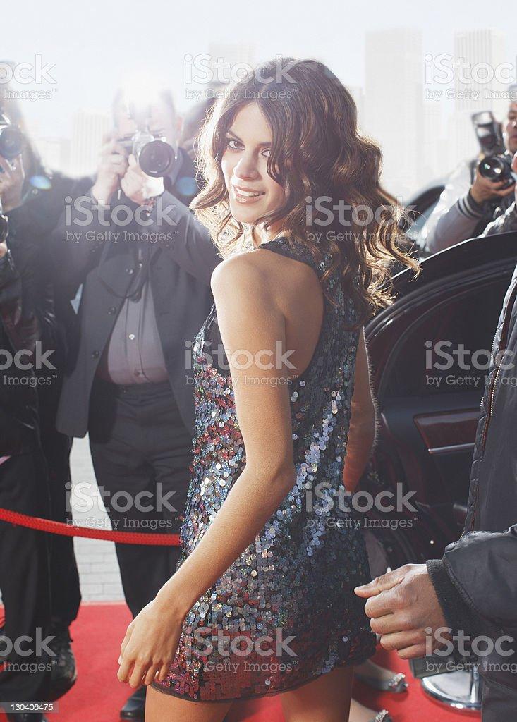 Celebrity walking on red carpet royalty-free stock photo