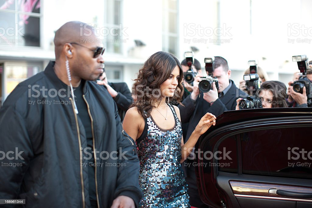 Celebrity walking to car on red carpet royalty-free stock photo