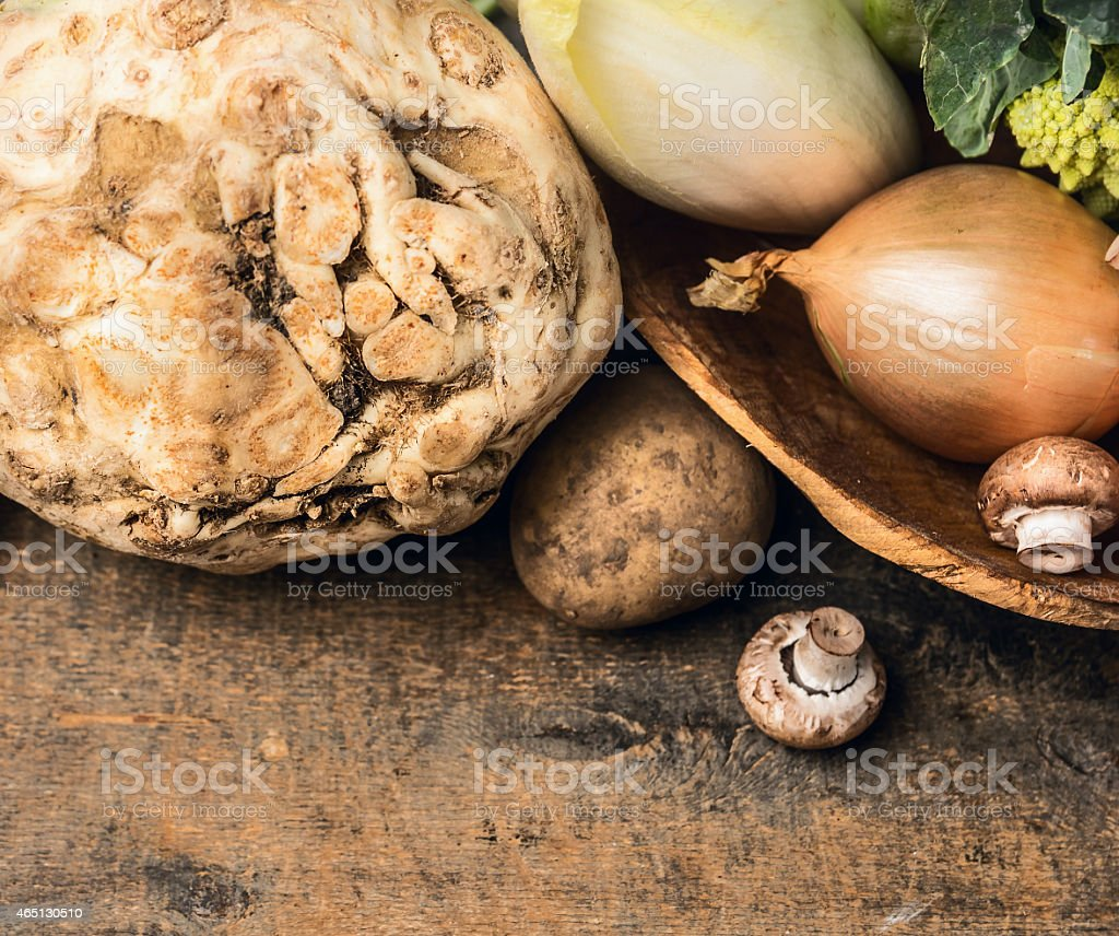 celery and vegetables in bowl on wooden background, top view stock photo