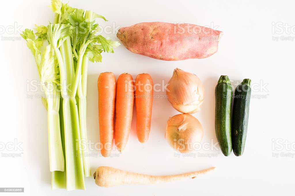 Celery, carrots, onions, sweet potato, zucchini and parnsip from above stock photo