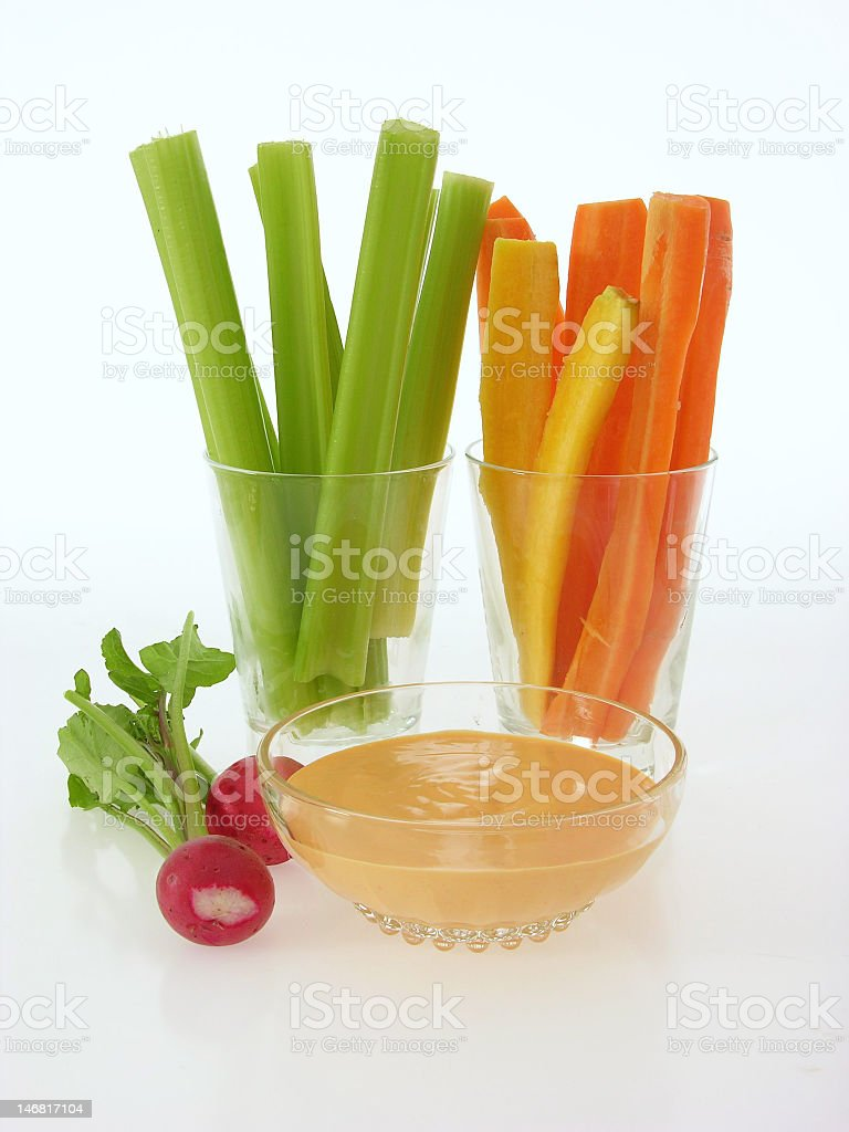 Celery, radishes, carrots, bell pepper, cup of vegetable dip royalty-free stock photo