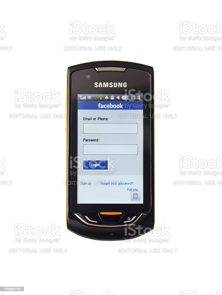 Cell phone accessing Facebook royalty-free stock photo