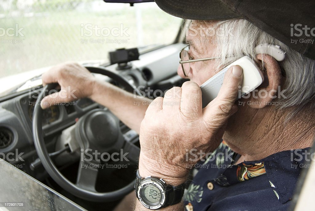 Cell phone and driving royalty-free stock photo