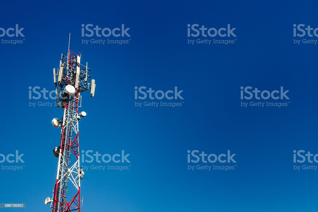 Cell phone antenna tower with blue sky background stock photo
