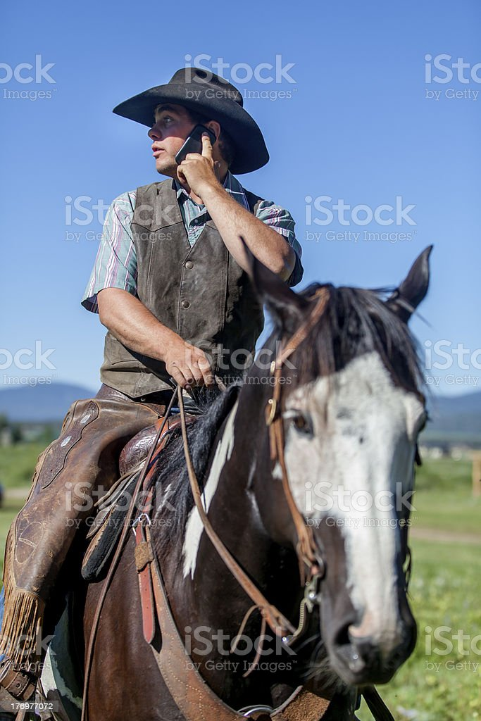 Cell Phone Cowboy stock photo