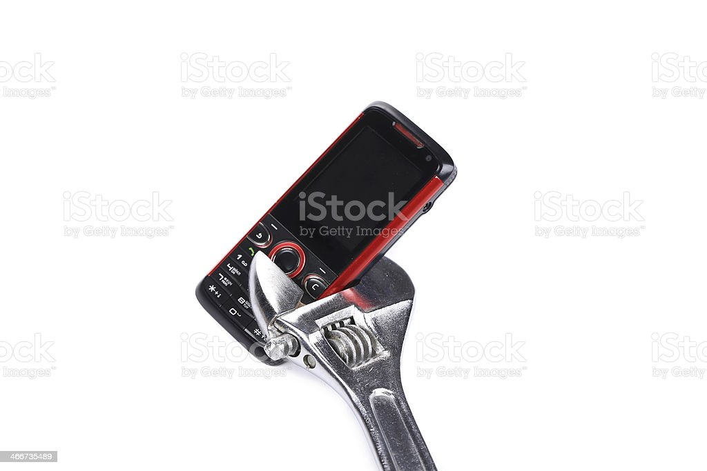 Cell phone in a wrench. stock photo