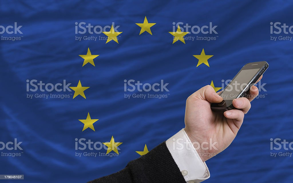 cell phone in front  national flag of europe royalty-free stock photo