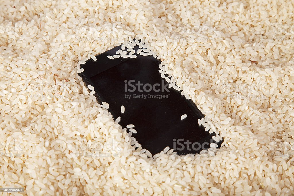 Cell phone in rice stock photo