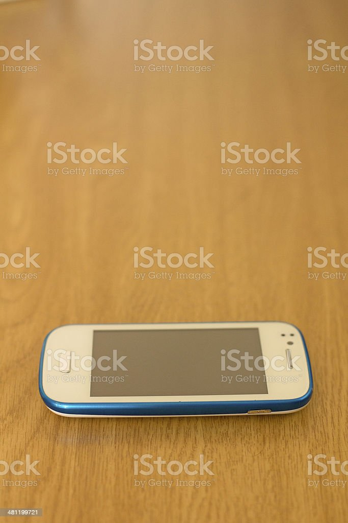 cell phone on table stock photo