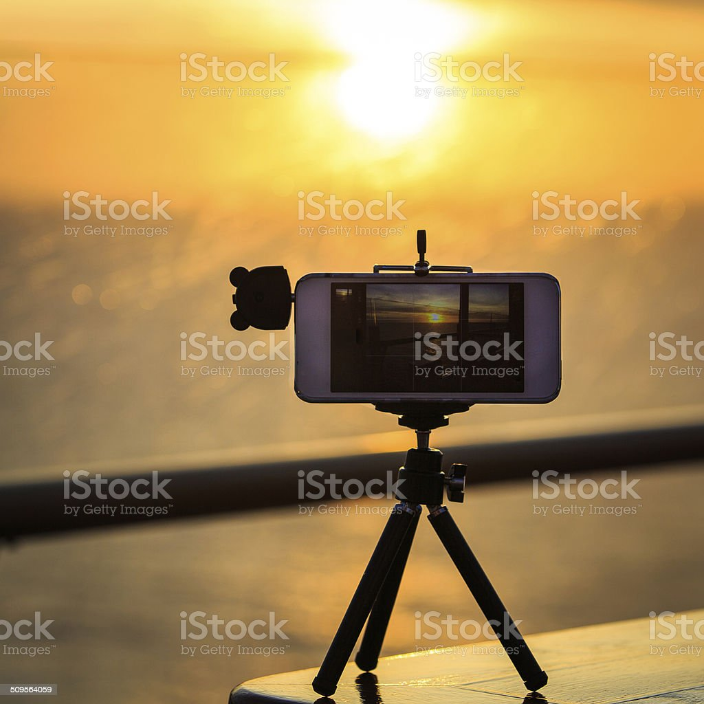 cell phone on tripod stock photo