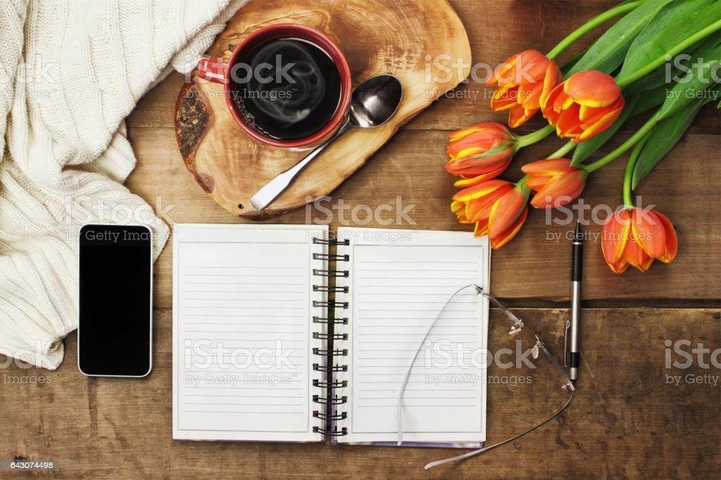 Cell Phone, Open Book and Tulip Flowers stock photo