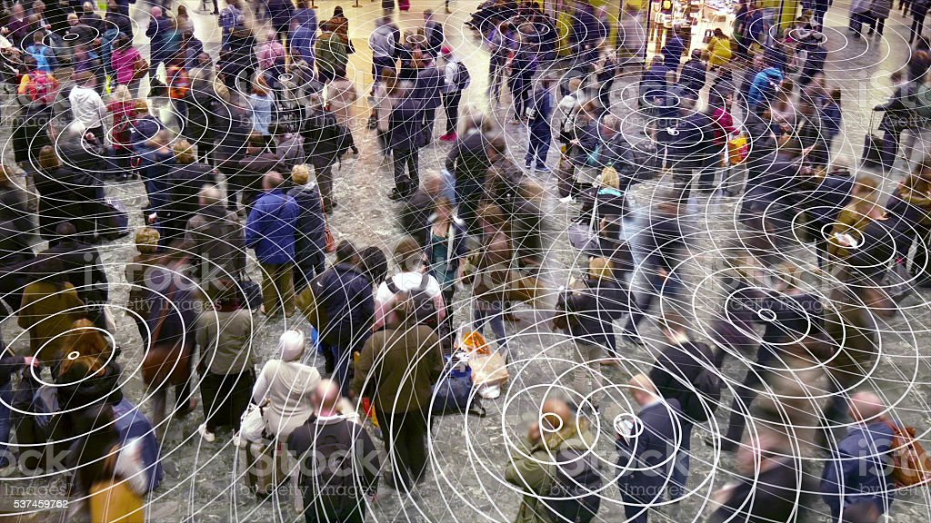 Cell phone radio signals in a crowd of people. stock photo