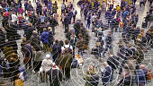 Cell phone radio signals in a crowd of people.