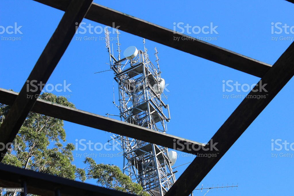 Cell phone tower and house stock photo