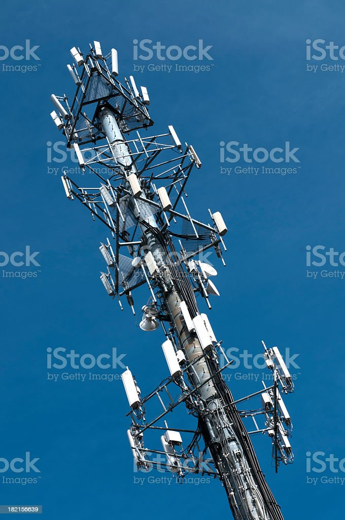 A cell phone tower with blue sky stock photo