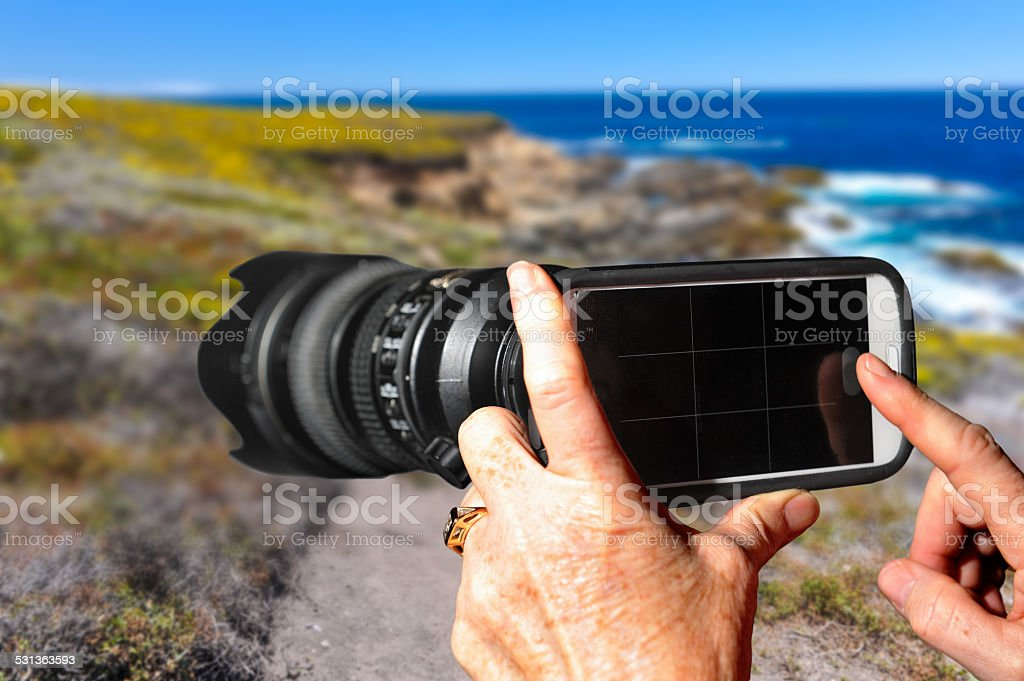 Cell Phone with a Telephoto Lens Attached stock photo